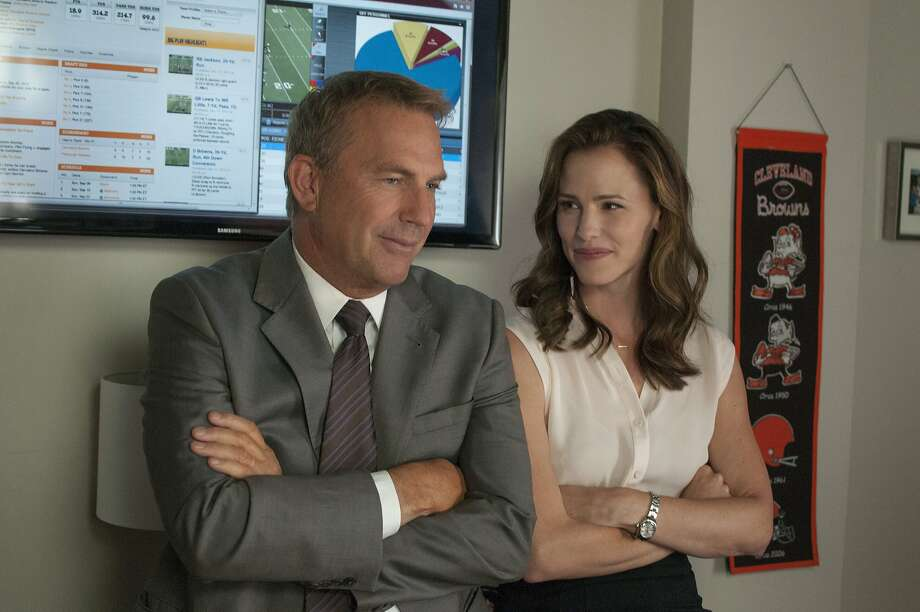 "Kevin Costner and Jennifer Garner work behind the scenes for the Cleveland Browns in ""Draft Day."" Photo: Dale Robinette, Summit Entertainment"