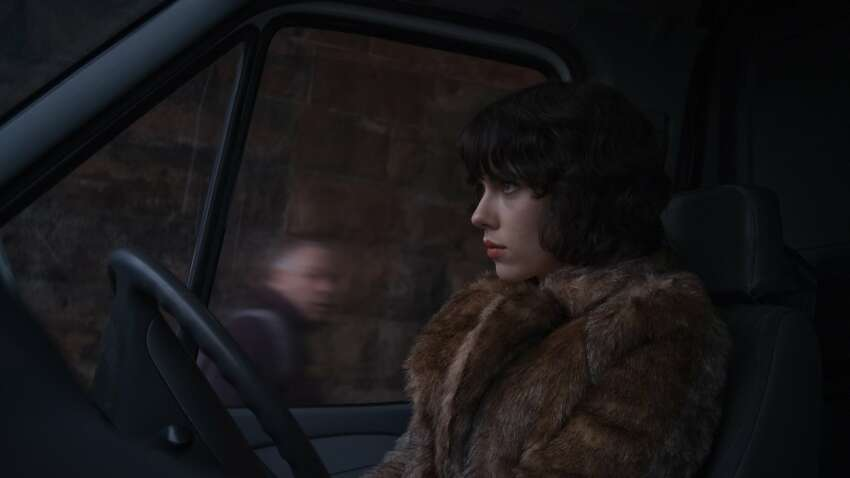 Scarlett Johansson plays a mysterious woman who drives around Glasgow, Scotland, in a van, inviting men who live alone to join her.