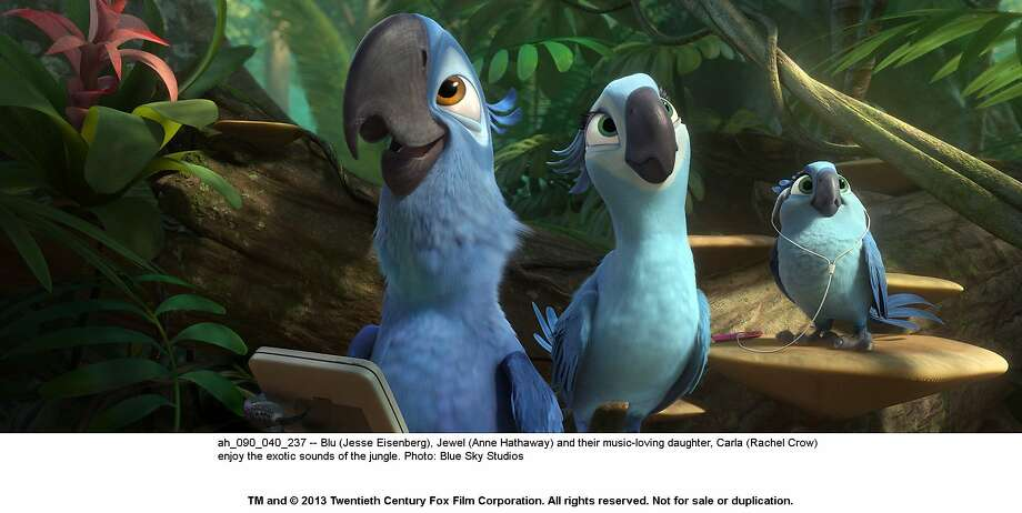 "Blu (Jesse Eisenberg), Jewel (Anne Hathaway) and their music-loving daughter, Carla (Rachel Crow) enjoy the exotic sounds of the jungle in, ""Rio 2."" Photo: Blue Sky Studios, Twenieth Century Fox"
