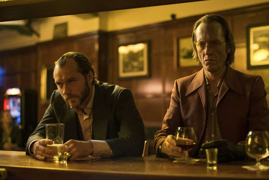 "Crooks Dom (Jude Law, left) and Dickie (Richard E. Grant) find themselves in the thick of things in ""Dom Hemingway."" Photo: Nick Wall, Fox Searchlight"