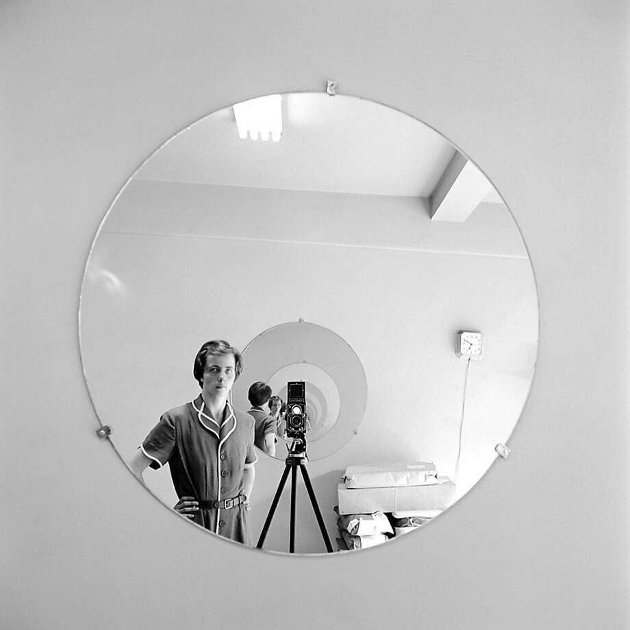 Vivian Maier in a self-portrait. Many of her photos were taken as she went about her duties as a nanny. Photo: Vivian Maier, IFC Films