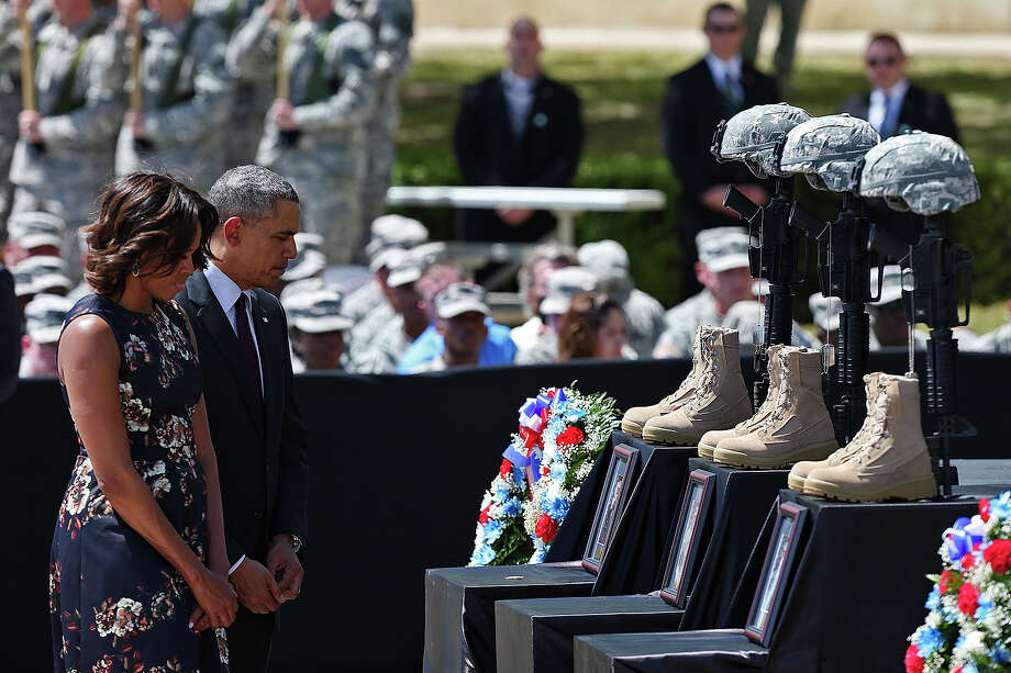 President Barack Obama and First Lady Michelle Obama the III Corps and Fort Hood Memorial Ceremony after paying their last respects, Wednesday, April 9, 2014. Sgt. First Class Daniel Michael Ferguson, Staff Sgt. Carlos Alberto Lazaney-Rodriguez and Sgt. Timothy Wayne Owens were killed and 16 others wounded when Spec. Ivan Lopez opened fire the April 2 attack at the installation. Lopez committed suicide after the attack. Photo: Jerry Lara, San Antonio Express-News / ©2014 San Antonio Express-News