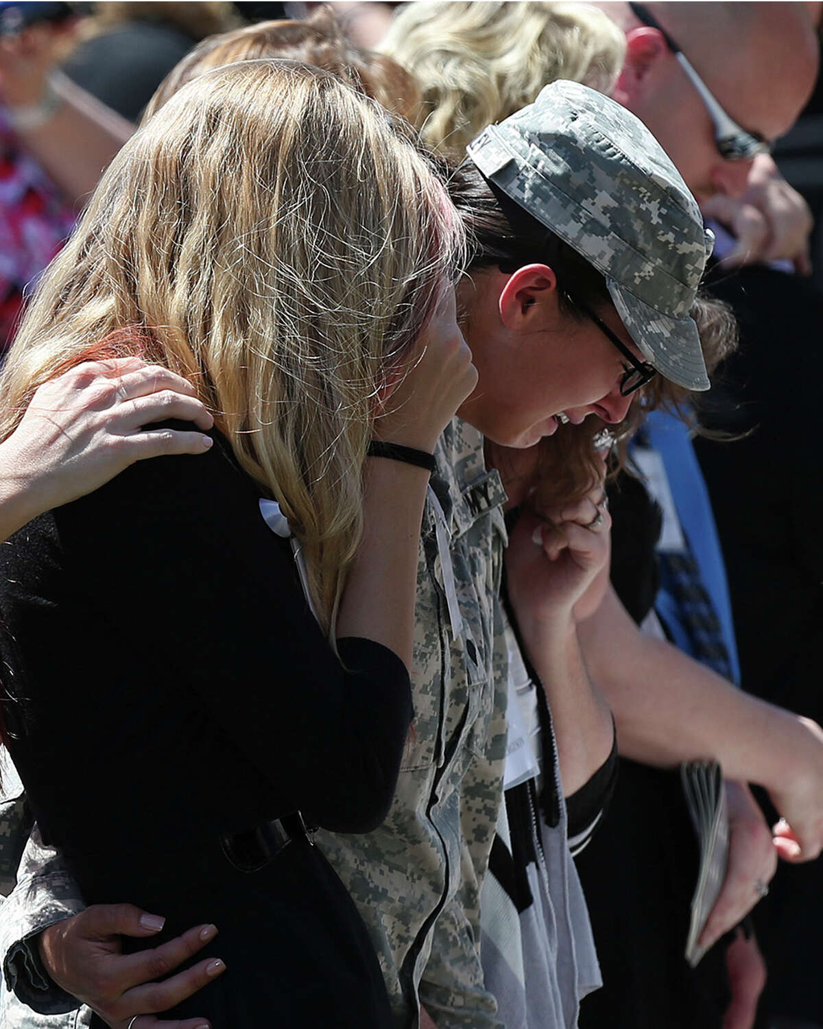 Mourners react during the III Corps and Fort Hood Memorial Ceremony, Wednesday, April 9, 2014. Sgt. First Class Daniel Michael Ferguson, Staff Sgt. Carlos Alberto Lazaney-Rodriguez and Sgt. Timothy Wayne Owens were killed and 16 others wounded when Spec. Ivan Lopez opened fire the April 2 attack at the installation. Lopez committed suicide after the attack. President Barack Obama and First Lady Michelle Obama attended the ceremony.