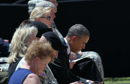 President Barack Obama bows his head during the III Corps and Fort Hood Memorial Ceremony, Wednesday, April 9, 2014. Sgt. First Class Daniel Michael Ferguson, Staff Sgt. Carlos Alberto Lazaney-Rodriguez and Sgt. Timothy Wayne Owens were killed and 16 others wounded when Spec. Ivan Lopez opened fire the April 2 attack at the installation. Lopez committed suicide after the attack. First Lady Michelle Obama also attended the ceremony. Photo: Jerry Lara, San Antonio Express-News / ©2014 San Antonio Express-News
