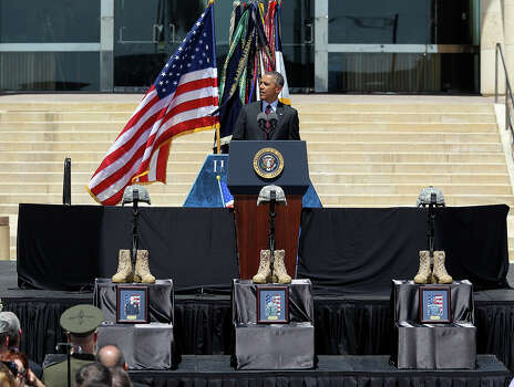 President Barack Obama speaks during the III Corps and Fort Hood Memorial Ceremony, Wednesday, April 9, 2014. Sgt. First Class Daniel Michael Ferguson, Staff Sgt. Carlos Alberto Lazaney-Rodriguez and Sgt. Timothy Wayne Owens were killed and 16 others wounded when Spec. Ivan Lopez opened fire the April 2 attack at the installation. Lopez committed suicide after the attack. Photo: Jerry Lara, San Antonio Express-News / ©2014 San Antonio Express-News