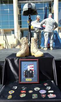 Photo of the Fallen Soldier Memorial for Sgt. First Class Daniel Michael Ferguson after the III Corps and Fort Hood Memorial Ceremony, Wednesday, April 9, 2014.  Ferguson along with Staff Sgt. Carlos Alberto Lazaney-Rodriguez and Sgt. Timothy Wayne Owens were killed and 16 others wounded when Spec. Ivan Lopez opened fire the April 2 attack at the installation. Lopez committed suicide after the attack. Photo: Jerry Lara, San Antonio Express-News / ©2014 San Antonio Express-News