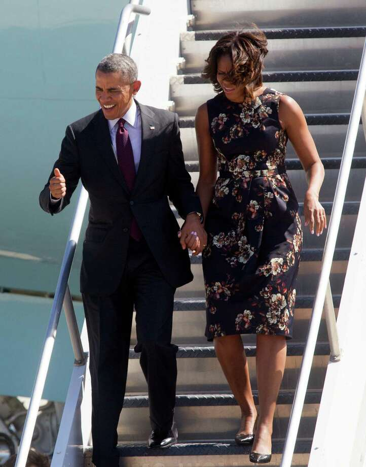 The Obamas at Bush airport. Photo: Bob Levey, Associated Press / FR156786 AP