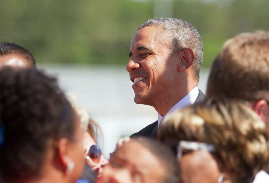 Obama greets the crowd at Bush airport. Photo: Bob Levey, Associated Press / FR156786 AP