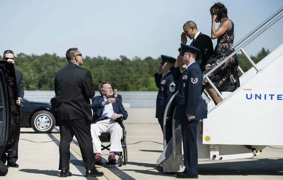 Former President George H.W. Bush welcomes President Obama