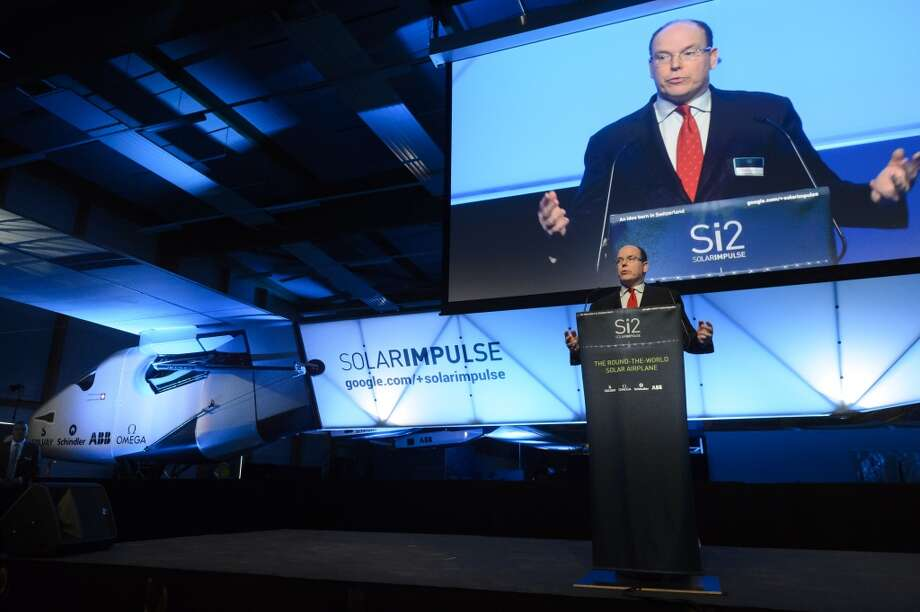 "Solar Impulse Godfather Prince Albert of Monaco speaks in front of the new experimental aircraft ""Solar Impulse 2"" during the official presentation at the airbase in Payerne, Switzerland on  Wednesday, April 9, 2014. Photo: Laurent Gillieron, Associated Press"