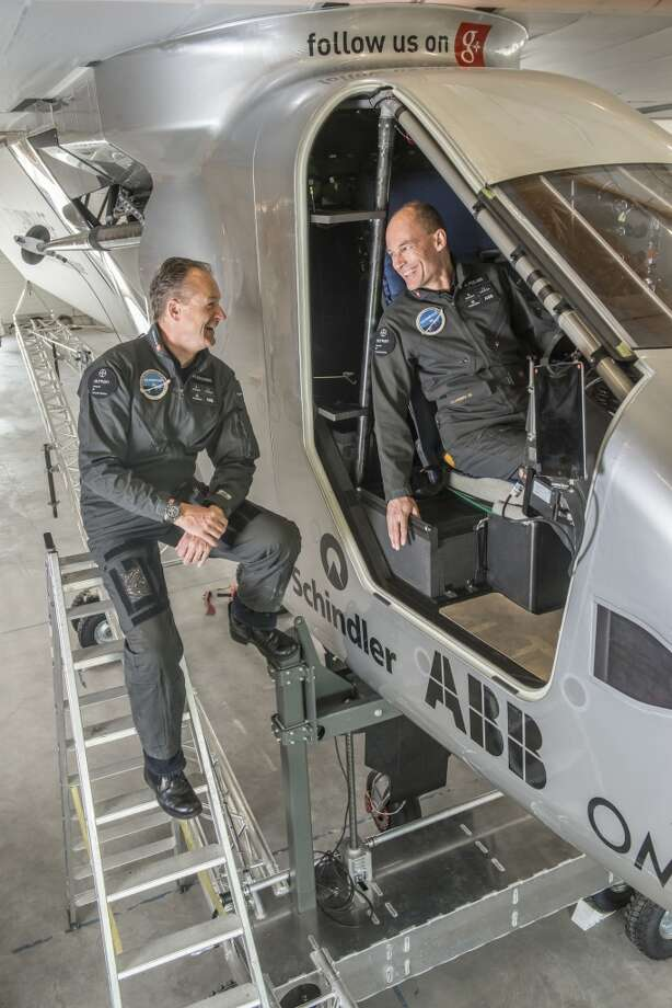 Swiss pioneers Bertrand Piccard (left) and Andre Borschberg are the founders, pilots and life force behind Solar Impulse 2. In 2015 the plane is due to make the first round-the-world solar flight, day and night without any fuel. This revolutionary single-seater aircraft made of carbon fibre has a 236 ft (72 meter) wingspan (larger than that of the Boeing 747-8I) and weighs the same as a car (5,000 lbs. or 2,300 Kg). The 17,000 solar cell, built into the wing, supply four electric motors (17.5 CV each). During the day, the solar cells recharge lithium batteries weighing 2077 lbs. (633 Kg), which allow the aircraft to fly at night. Each pilot will fly for 4-5 days. They will need 2.4 kg of food, 2.5 l of water and 1l of sports drink per day: additional weight that needs to be carefully calculated by the Solar Impulse team. In case of an emergency, the pilot seat has an integrated parachute and life raft. (Jean Revillard for Solar Impulse 2 via AP Images) Photo: Jean Revillard, Associated Press