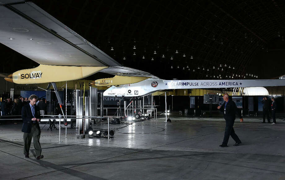 The Solar Impulse solar-powered plane is displayed in a hangar at Moffett Field in March 2013 in Mountain View, California. The Solar Impulse has already made international and intercontinental flights in Europe and Africa. Photo: Justin Sullivan, Getty Images / 2013 Getty Images