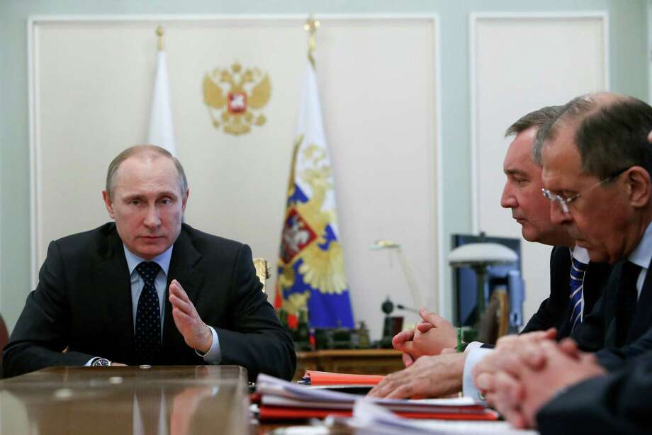 Russian President Vladimir Putin speaks at a Cabinet meeting Wednesday. Putin's game in Ukraine is like playing hockey without a referee. Photo: Sergei Karpukhin, Associated Press / REUTERS POOL
