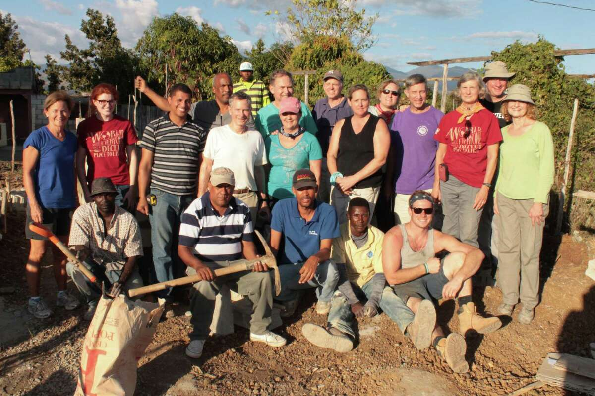 The mission trip group from the First Congregational Church of Darien with local Habitat for Humanity workers in the Dominican Republic.