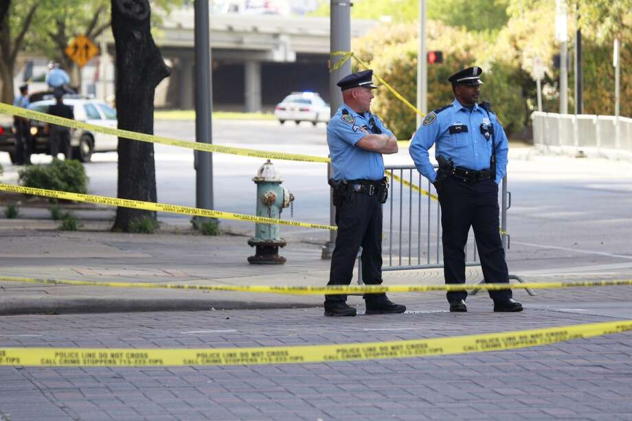 Police stand at Smith and Pease, where the streets are closed for the Obamas. Photo: Melissa Phillip, Chronicle