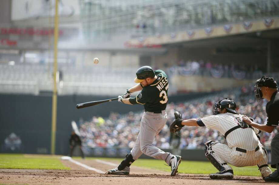Brandon Moss of the A's singles scoring two runs in the first inning as the Minnesota Twins hosted the Oakland A's at Target Field April 9, 2014 in Minneapolis. Photo: Jerry Holt, McClatchy-Tribune News Service