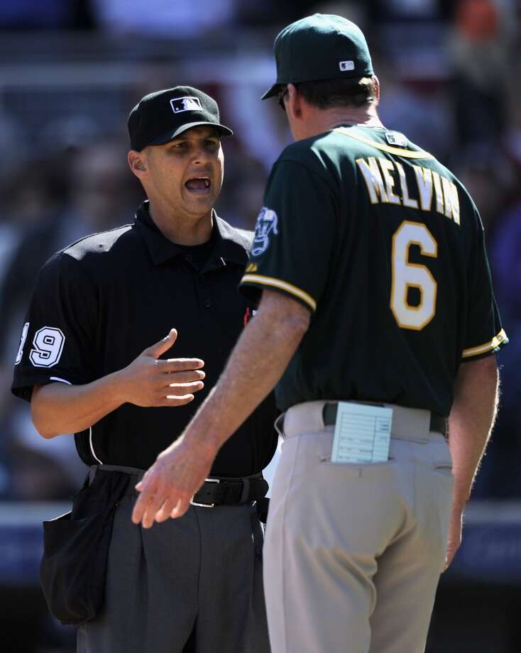 Umpire Vic Carapazza #19 speaks with Bob Melvin #6 of the Oakland Athletics during the ninth inning of the game against the Minnesota Twins on April 9, 2014 at Target Field in Minneapolis, Minnesota. The Athletics defeated the Twins 7-4 in eleven innings. Photo: Hannah Foslien, Getty Images