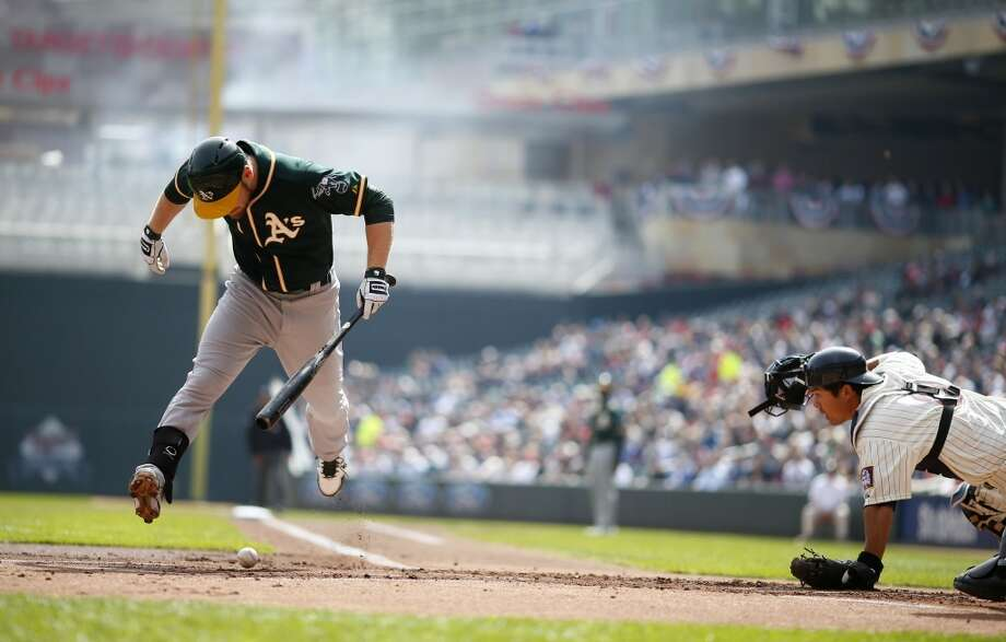 Oakland's Brandon Moss jumps out of the way of a pitch thrown by Phil Hughes in the first inning as the Minnesota Twins hosted the Oakland A's at Target Field  April 9, 2014 in Minneapolis. Photo: Jerry Holt, McClatchy-Tribune News Service