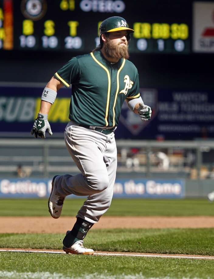 Oakland Athletics catcher Derek Norris (36) rounds the bases for his 3 run home run against the Minnesota Twins in the 11th inning at Target Field. Athletics win 7-4 in 11 innings. Photo: Bruce Kluckhohn, Reuters