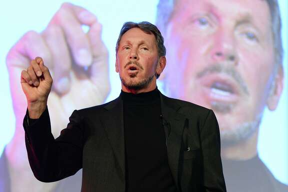 Larry Ellison, CEO of Oracle Corporation, gestures as he makes a speech during the New Economy Summit 2014 in Tokyo on April 9, 2014.  More than 1,000 business leaders, entrepreneurs, businessmen and students took part in the two-day forum.     AFP PHOTO/Toru YAMANAKATORU YAMANAKA/AFP/Getty Images