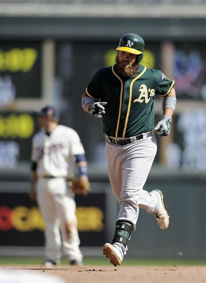 Derek Norris rounds the bases on his three-run homer in the 11th inning. Photo: Hannah Foslien, Getty Images