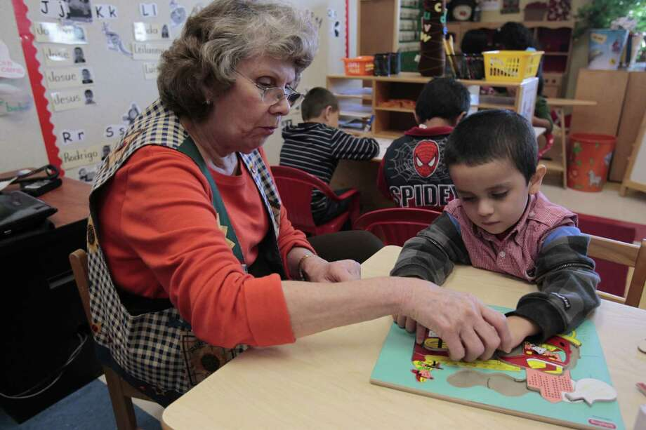 (l-r) Pre-K teacher Donna Barthel works on a puzzle with Brandon Vargus during a language lab time at Lion Lane School,Tuesday, Oct. 30, 2012, in Houston.  ( Billy Smith II / Houston Chronicle ) Photo: Billy Smith II, Staff / © 2012 Houston Chronicle