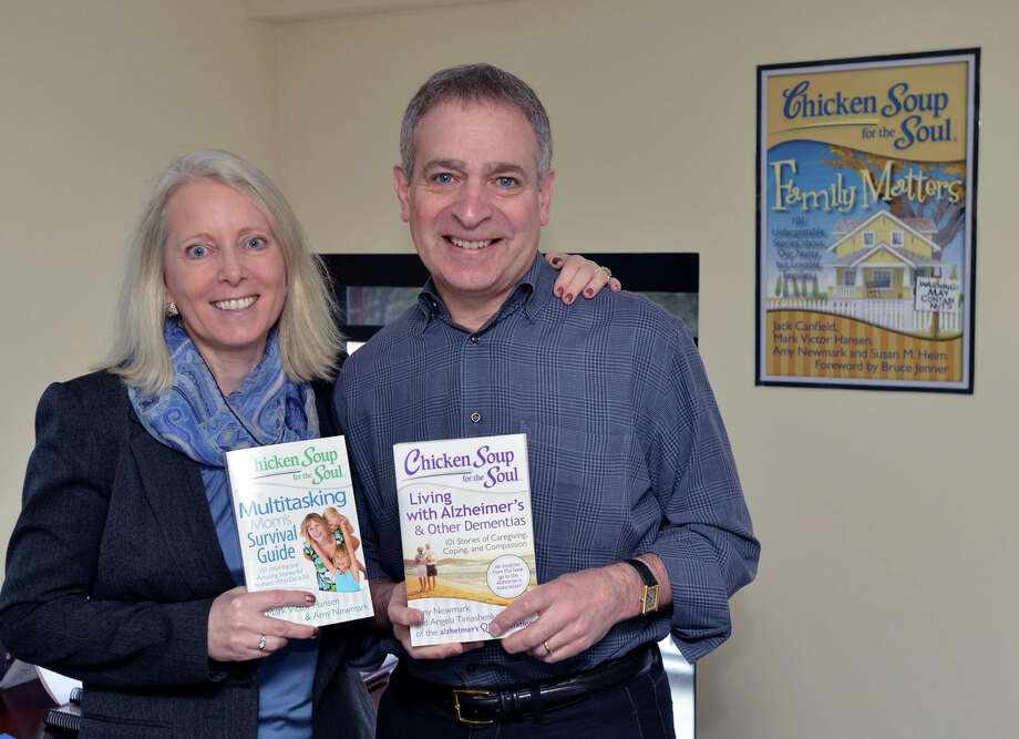 Bill Rouhana Jr., the chairman and chief executive officer of the Chicken Soup for the Soul Company, with his wife, Amy Newmark, who is the publisher for the company, at company's headquarters in the Cos Cob section of Greenwich, Conn., Wednesday, April 9, 2014. The publishing house has more than 250 titles and has recently branched out into specialty foods and pet foods. Photo: Bob Luckey / Greenwich Time