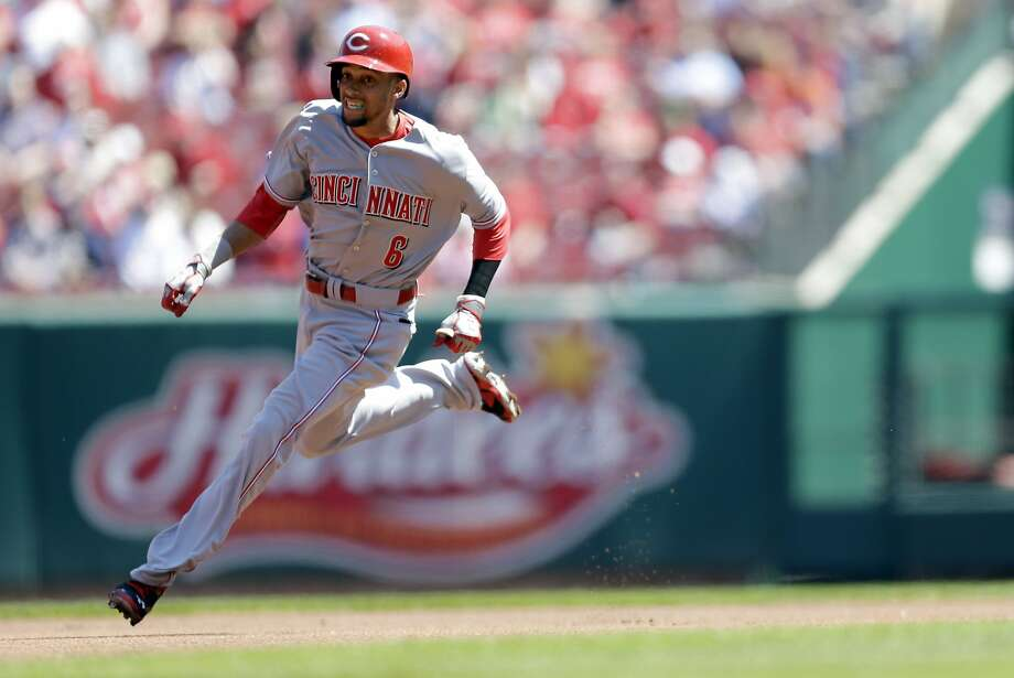 Cincinnati Reds' Billy Hamilton heads to third for a triple during the first inning of a baseball game against the St. Louis Cardinals Wednesday, April 9, 2014, in St. Louis. (AP Photo/Jeff Roberson) Photo: Jeff Roberson, Associated Press