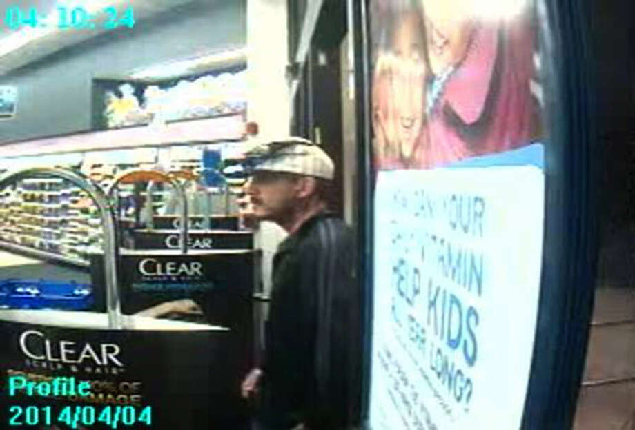 Police are searching for a man who used a large kitchen knife to pry open a cash register at a Southeast Side Walgreens last week. Photo: COURTESY
