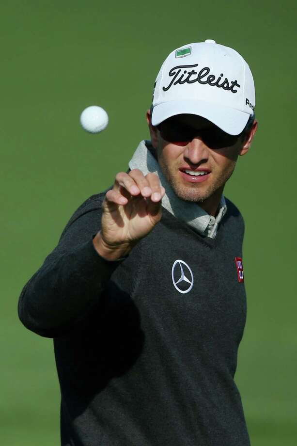 AUGUSTA, GA - APRIL 09:  Adam Scott of Australia reaches for a golf ball on the practice ground during a practice round prior to the start of the 2014 Masters Tournament at Augusta National Golf Club on April 9, 2014 in Augusta, Georgia.  (Photo by Andrew Redington/Getty Images) ORG XMIT: 461742817 Photo: Andrew Redington / 2014 Getty Images