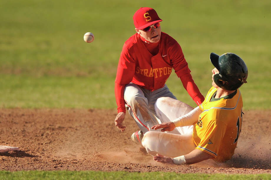 Stratford's Joseph Marsan misses the throw to second allowing Trinity Catholic's Matt Christensen to slide in safe during their baseball game at Trinity Catholic High School in Stamford, Conn., on Wednesday, April 9, 2014. Trinity Catholic won, 4-2. Photo: Jason Rearick / Stamford Advocate