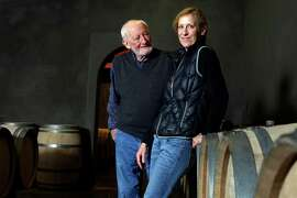 Philip Togni and his daughter Lisa stands among their family wine barrels at the Philip Togni Winery in St. Helena.