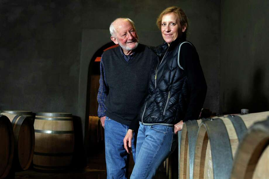 Philip Togni and his daughter Lisa stands among their family wine barrels at the Philip Togni Winery in St. Helena. Photo: Lacy Atkins / The Chronicle / ONLINE_YES