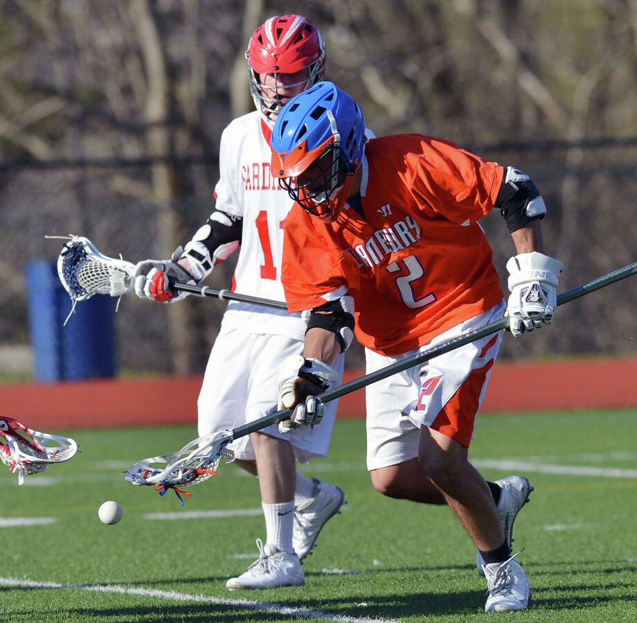 Danbury's Thomas O'Rourke (#2) scoops up the ball during the boys high school lacrosse match between Greenwich High School and Danbury High School at Greenwich, Wednesday, April 9, 2014. Greenwich won the match, 19-3. Photo: Bob Luckey / Greenwich Time