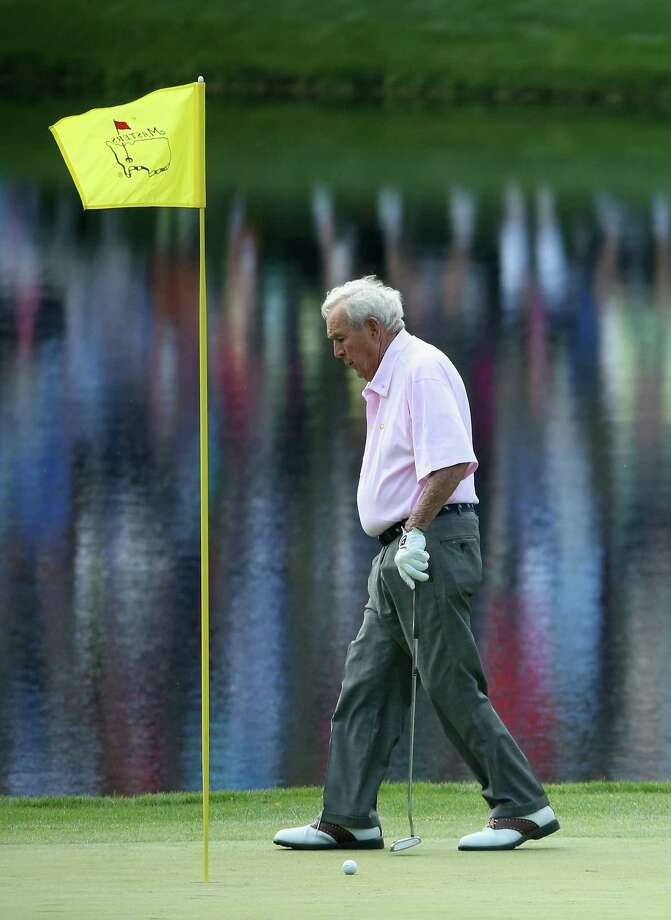 AUGUSTA, GA - APRIL 09:  Arnold Palmer walks off a green during the 2014 Par 3 Contest prior to the start of the 2014 Masters Tournament at Augusta National Golf Club on April 9, 2014 in Augusta, Georgia.  (Photo by Andrew Redington/Getty Images) ORG XMIT: 461742817 Photo: Andrew Redington / 2014 Getty Images