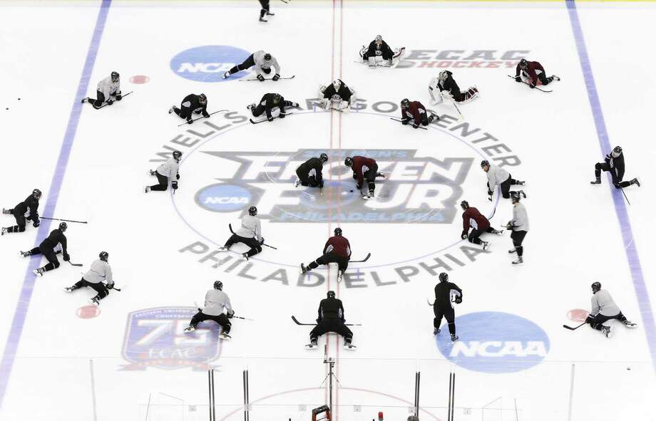 Members of the Union hockey team stretch during team practice for the NCAA men's college hockey Frozen Four tournament Wednesday, April 9, 2014, in Philadelphia. Union faces Boston College in a semifinal match on Thursday. (AP Photo/Matt Rourke) ORG XMIT: PXC101 Photo: Matt Rourke / AP