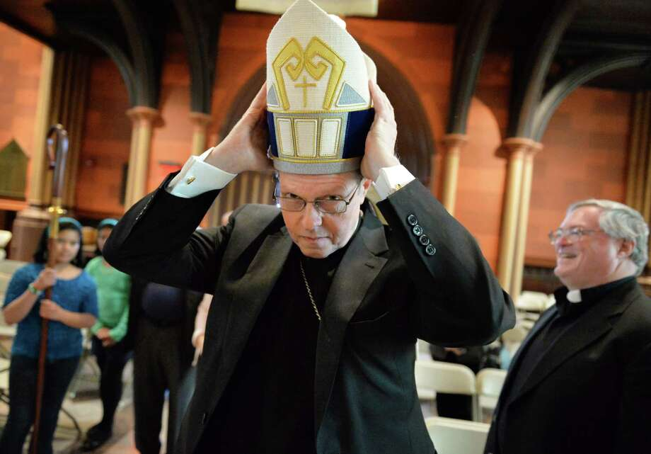 Bishop-elect Scharfenberger tries on a Miter during rehearsal for his installation at the Cathedral of Immaculate Conception Wednesday afternoon, April 9, 2014, in Albany, N.Y.   (John Carl D'Annibale / Times Union) Photo: John Carl D'Annibale / 00026438A