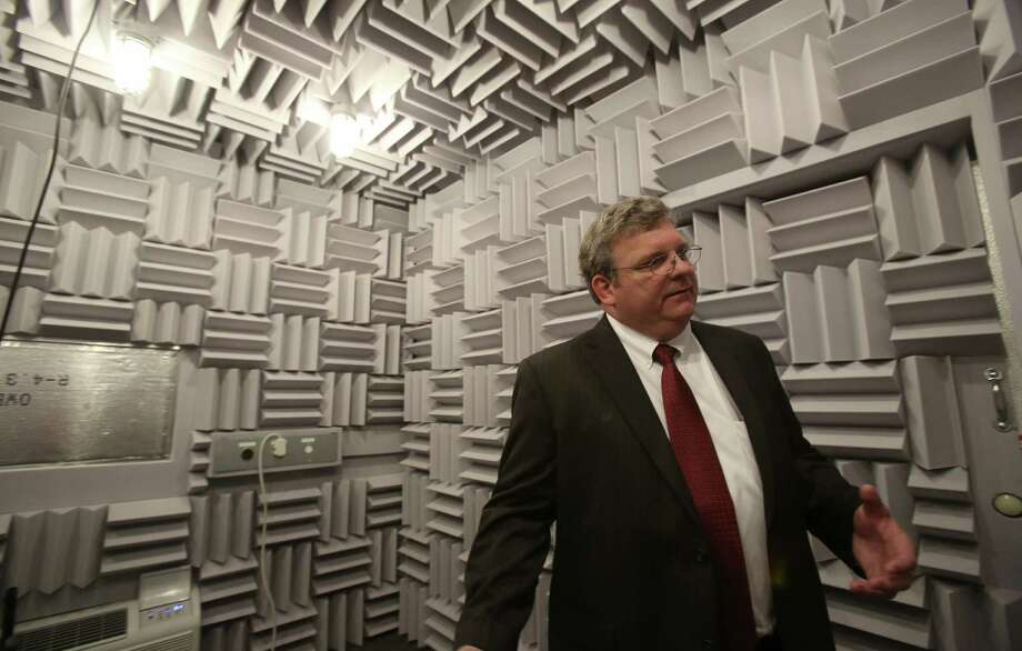 David Lingrey, vice president of engineering for the locally based Friedrich Air Conditioning Co., explains how the acoustic chamber is used in the manufacturer's new design and development center. Photo: Helen L. Montoya, San Antonio Express-News / ©2013 San Antonio Express-News