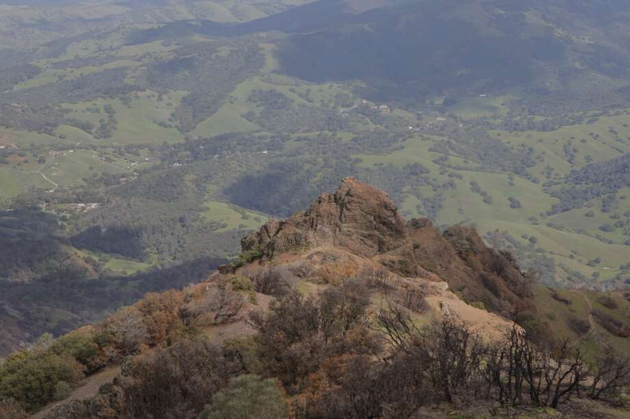 Near summit of Mount Diablo, you can peer down at Devil's Pulpit, where fire burned in mosaic pattern, and beyond in background to the east into the green, untouched valley and foothills below Photo: Tom Stienstra