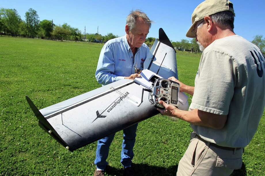 Tim Miller, founder of EquuSearch, left, and Gene Robinson, who builds its drones, check out one in Santa Fe in Galveston County in April. Photo: Mayra Beltran, Staff / © 2014 Houston Chronicle