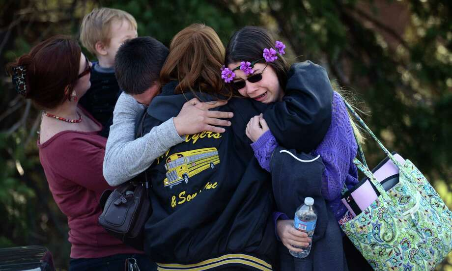 Parents and students embrace near Franklin Regional High School after more than a dozen students were stabbed during a rampage by a boy described as having a blank expression. Photo: Sean Stipp / Tribune Review / Tribune Review