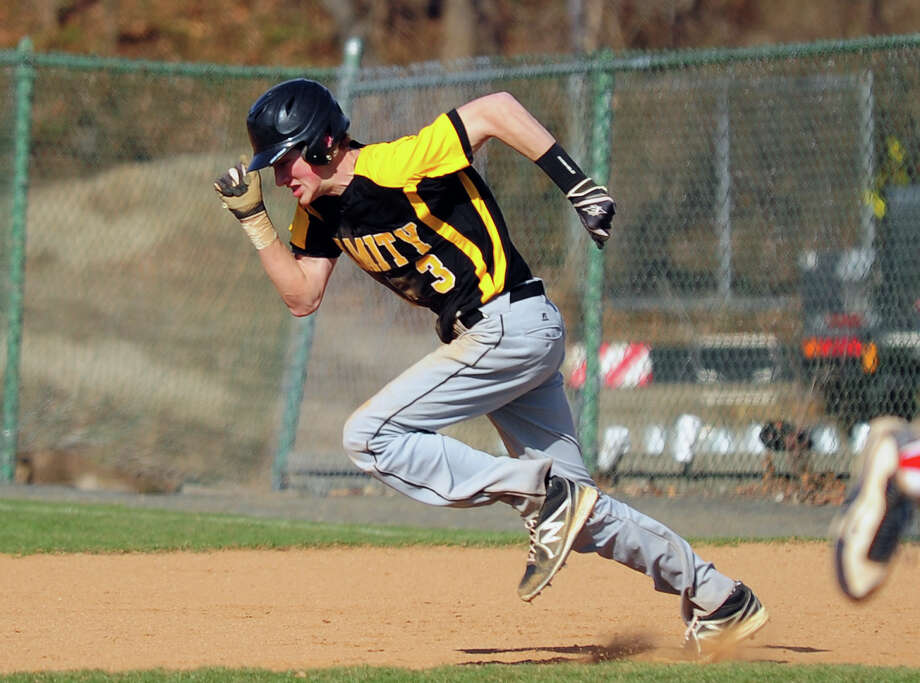 Amity's Christopher Winkel heads to second, during opening day baseball action against Fairfield Prep at Fairfield University in Fairfield, Conn. on Wednesday April 9, 2014. Photo: Christian Abraham / Connecticut Post