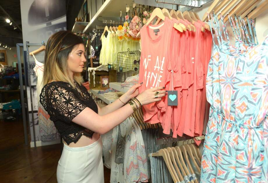 Kylie Jenner checks out t-shirts during Kendall & Kylie's Spring Collection Launch at PacSun in San Jose, Calif. on Saturday, April 5, 2014. Photo:  John Shearer/Invision For PacSun/AP Images