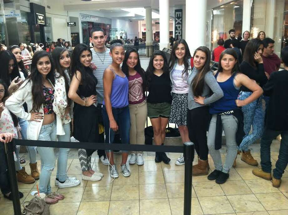 Fans outside of PacSun during Kendall & Kylie's Spring Collection launch. They said they'd waited for 8 hours to see Kendall and Kylie, and were still over 200 people away from doing so at 4 pm. From left to right: Left to right: Haide Santana, Aubrey Kaho, Bryanna Ayala, Katelyn Brolin, Larissa Contreras, Steve Perlera, Laylanie Arriaga, Rebeca Marquez and Daisy Espinoza. The group of strangers bonded after an 8 hour wait in line. Photo: Photo By Valerie Demicheva's IPhone