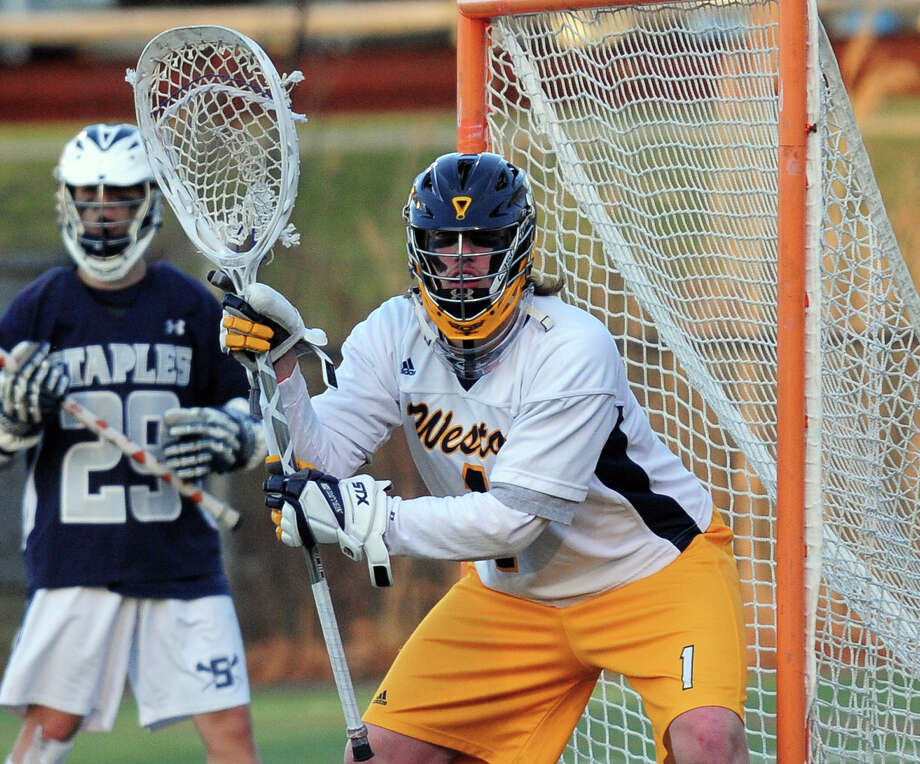 Lacrosse action between Staples and Weston in Westport, Conn. on Wednesday April 9, 2014. Photo: Christian Abraham / Connecticut Post