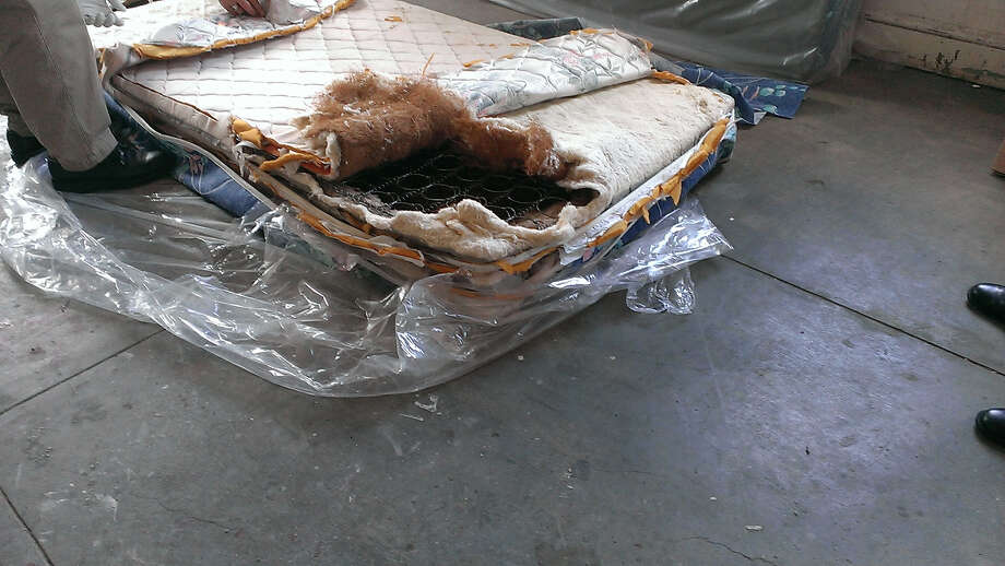 Albany County alleges that 99 Cents and More, a store on South Pearl Street in Albany, has sold unsanitary used mattresses, like the one pictured here, that were masked with a fresh-looking exterior. (Photo provided by Albany County)