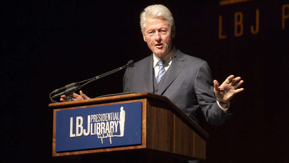 Former President Bill Clinton addresses the audience during the Civil Rights Summit, which commemorates Lyndon B. Johnson's signing the 1964 Civil Rights Act, at the LBJ Presidential Library on the University of Texas campus in Austin. Photo: Deborah Cannon / Photo Pool / PHOTO POOL