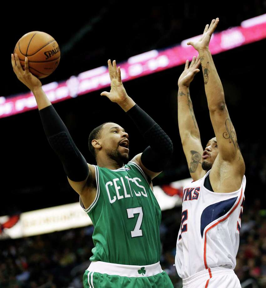 Boston Celtics' Jared Sullinger, left, puts up a shot against Atlanta Hawks' Mike Scott in the fourth quarter of an NBA basketball game, Wednesday, April 9, 2014, in Atlanta. The Hawks won 105-97. (AP Photo/David Goldman) ORG XMIT: GADG120 Photo: David Goldman / AP