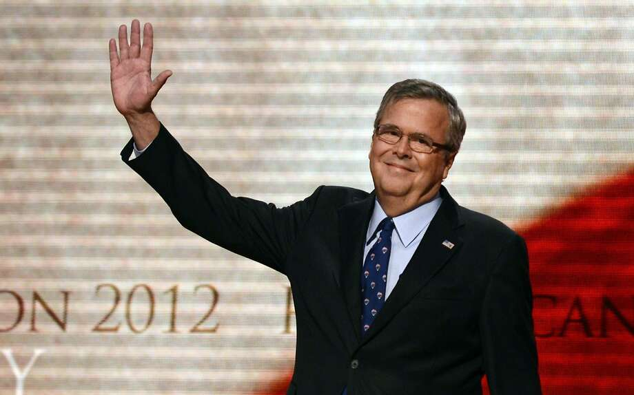 "With AFP Story by Michael MATHES: US-politics-vote-Republicans-Bush,FOCUS(FILES): This  August 30, 2012 file photo shows former Florida Governor Jeb Bush waving  to the audience on the final day of the Republican National Convention (RNC) at the Tampa Bay Times Forum in Tampa, Florida.  Last year family matriarch Barbara Bush proclaimed there have been ""enough Bushes"" in the White House, but recently son Jeb unambiguously revived prospects of extending the political dynasty.    AFP PHOTO / Files/  Brendan SMIALOWSKIBRENDAN SMIALOWSKI/AFP/Getty Images Photo: Brendan Smialowski, AFP/Getty Images"