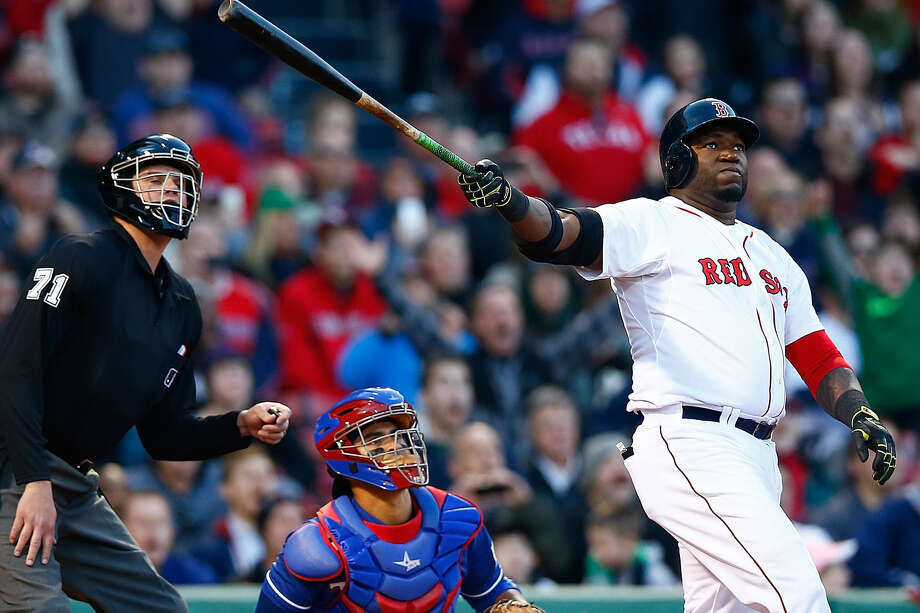 Boston's David Ortiz (right) watches the flight of his three-run homer in the eighth at Fenway Park. Photo: Jared Wickerham / Getty Images / 2014 Getty Images